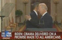 Joe Biden whispers