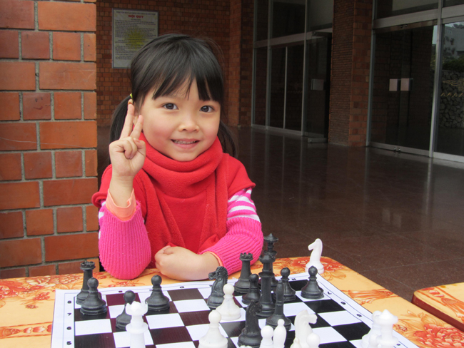 """This chess cherub would have defeated me in three minutes had I not utilized a daring, obscure strategy – the Wizard's Distraction: I exclaim, """"Look, a scary monster!"""", my opponent turns to look, and I steal her bishop."""