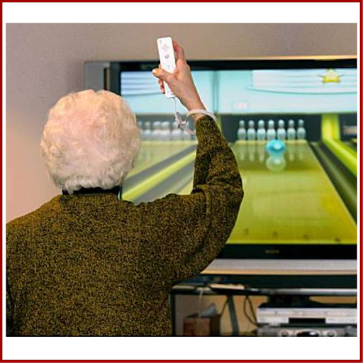 This elderly woman is staying indoors and enjoying her sports safely. See how she's holding a Nintendo Wii game controller. Unfortunately she thinks it's a TV remote, and she can't figure out how to change from bowling to her favorite quilting show.