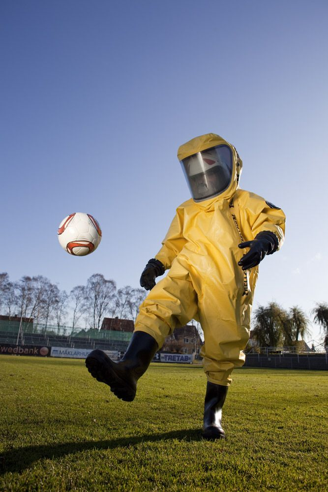 The Coronavirus doesn't mean an end to sports. It just means taking a few common-sense precautions for your safety. Take this striker for Arsenal Soccer. He can continue to play with no worries – just so long as his helmet doesn't fog up.